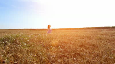 stock-footage-little-girl-running-cross-the-wheat-field-at-sunset-high-speed-camera-slow-motion